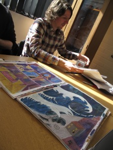 Chris Hagan with some of the art he created for Seawater - story and script by Jim Holland